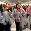 Danvers:<br /> Marilyn Deschenes, left, and Debbie Petroccione. both of Beverly, carry the bargins they purchased in bags, after leaving the check out counter at Kohl's department store. Black Friday sent shoppers swarming the stores looking for bargains.<br /> Photo by Ken Yuszkus/Salem News, Friday November 28, 2008.