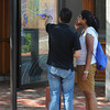 Salem:<br /> Peter and Nimmy Tsouratakis of New York City stop to look at a map of Salem while walking along Essex Street.<br /> Photo by Ken Yuszkus/The Salem News, Friday, September 7, 2012.