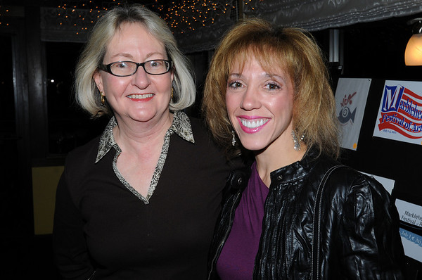 Marblehead:<br /> Barbara Day of Marblehead, left, and Christine Lucas, of Marblehead, who is one of the singers for Take Two, which performed at the event, attend the Marblehead Festival of Arts  Logo Premiere Party held at The Landing Restaurant on Tuesday January 25.<br /> Photo by Ken Yuszkus/Salem News, Tuesday, January 25, 2011.
