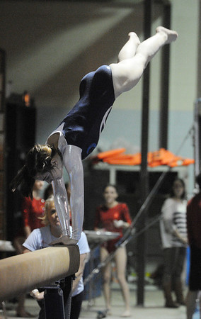 Peabody:<br /> Peabody's Kaylee Steele performs a dismount off the balance beam at the Masco at Peabody gymnastics meet at Peabody Veterans Memorial High School gymnasium.<br /> Photo by Ken Yuszkus/Salem News, Monday, January 9, 2012.