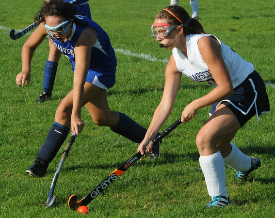 Swampscott:<br /> Danvers' Courtney Torchia , left, and Swampscott's Gabby Rizzo, go after the ball during the Danvers at Swampscott field hockey game.<br /> Photo by Ken Yuszkus/The Salem News, Wednesday, September 12, 2012.