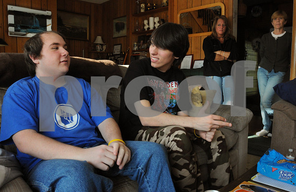 Danvers:<br /> From left, Mike Petrosino, Erik West, sit and talk as Elaine West, Erik's mother, and Paula Petrosino, Mike's mother, stand in the background at the West's home. The two juniors at Beverly High School have been diagnosed with a rare cancer called Ewings Sarcoma. Mike is helping Erik get through it.<br /> Photo by Ken Yuszkus/Salem News, Friday,  January 23, 2009.
