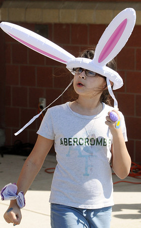 Salem:<br /> Clea Matt, of Danvers, wore bunny ears to the Mayor's annual Easter Eggstravaganza on the Bowditch School grounds<br /> Photo by Ken Yuszkus/Salem News, Saturday, April 3, 2010.