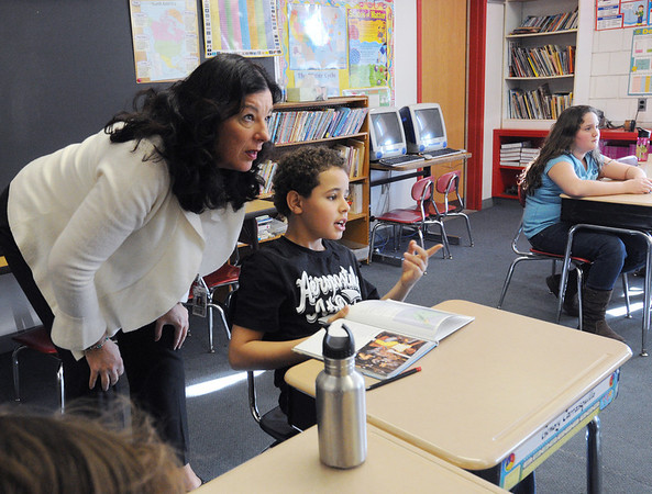 Salem:<br /> Principal Renata McFarland talks with 4th grader Gemery Carrasquillo in his class at the Bentley Elementary School during her morning rounds at the school.<br /> Photo by Ken Yuszkus/Salem News, Wednesday, January 18, 2012.
