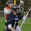 Beverly:<br /> Beverly's Nick Pinciaro, left, and Marblehead's Matt Putur fight for the loose ball during the Hamilton-Wenham at Beverly boys lacrosse game at Hurd Stadium.<br /> Photo by Ken Yuszkus/Salem News, Thursday, May 5, 2011.