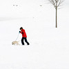 Beverly:<br /> A boy walks his dog in the snow at the Dane Street Beach.<br /> Photo by Ken Yuszkus/Salem News, Thursday, February 18, 2010.