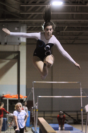 Peabody:<br /> Peabody's Michaela Rago performs a jump on the balance beam at the Masco at Peabody gymnastics meet at Peabody Veterans Memorial High School gymnasium.<br /> Photo by Ken Yuszkus/Salem News, Monday, January 9, 2012.