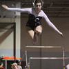 Peabody:<br /> Peabody's Michaela Rago performs a jump on the balance beam at the Masco at Peabody gymnastics meet at Peabody Veterans Memorial High School gymnasium.<br /> Photo by Ken Yuszkus/Salem News, Monday, January 9, 2012.