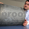 Salem:<br /> Alex Schnip of RCG is holding an old printing plate from Salem Evening News that was found in the old Salem Evening News building.<br /> Photo by Ken Yuszkus/Salem News,  Wednesday, June 3, 2009.