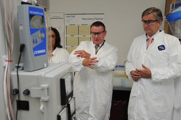 Beverly:<br /> Doug Clibourn, left, president and CEO of Velico Medical, explains the process of the machine used to dry plasma into powder to Congressman John Tierney, D-Salem.<br /> Photo by Ken Yuszkus/Salem News, Friday, August 12, 2011.