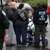 Peabody:<br /> Ambulance personnel attend one of the many people affected by carbon monoxide exposure on Central Street in Peabody Square.<br /> Photo by Ken Yuszkus/Salem News, Wednesday, March 31, 2010.