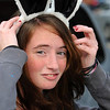 Beverly:<br /> Michelle Yescalis of Beverly, walks along Cabot Street with her rabbit ears and bunny tails on Monday afternoon. She occasionally dons rabbit ears or cat ears headbands.<br /> Photo by Ken Yuszkus/Salem News, Monday, October 24, 2011.