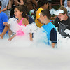 Danvers:<br /> Scores of children charge into the foam laid down by the Danvers Fire Department at the Fireman's Muster in Endicott Park.<br /> Photo by Ken Yuszkus/Salem News, Wednesday, July 13, 2011.