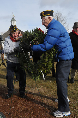 Hamilton:<br /> Wreaths Across America traveled through Hamilton and stops for wreath-laying ceremony. Red Butman, left, and Dick Briggs, both from the Hamilton American Legion, place the wreath at Patton Park.<br /> Photo by Ken Yuszkus/Salem News, Monday,  December 6, 2010.