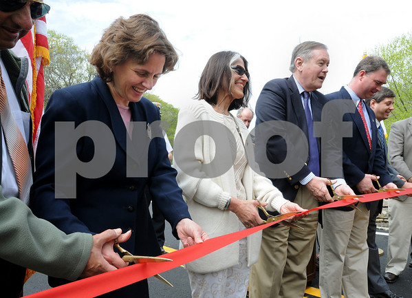 Hamilton:<br /> From left, Luisa Paiewonsky, commissioner of Massachusetts Highway, Ingrid Miles, Ipswich chairman of the board of selectmen, Bob Markel, Ipswich town manager, Representative Brad Hill, and Senator Bruce Tarr, cut the ribbon at the ceremony to reopen the Highland Street/Mill Road bridge. The bridge was closed for three years.<br /> Photo by Ken Yuszkus/Salem News, Friday May 8, 2009.