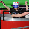Danvers:<br /> Mark Robertson, Jr. raises his arms while spinning on The Tubs of Fun ride at Plains Park before the fireworks. With him on the ride is his cousin Michelle Pabisz and her son Josh.<br /> Photo by Ken Yuszkus/Salem News, Tuesday, July 3,  2012.