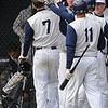 Wenham:<br /> Gordon's pitcher Eric Wolak, 7, is congratulated by his teammates as he comes into the dugout after his homerun which drove in a run at the Eastern Nazarene at Gordon College baseball home opener.<br /> Photo by Ken Yuszkus/Salem News, Wedesday, March 23, 2011.