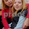 Beverly:<br /> Santa Vjakse, 12, is hugged by Ann Crowley. Santa is an orphan from Latvia and is in this country for a few weeks visiting Ann and her family. She received an operation in a Boston hospital for free.<br /> Photo by Ken Yuszkus/Salem News, Friday,  January 9, 2009.