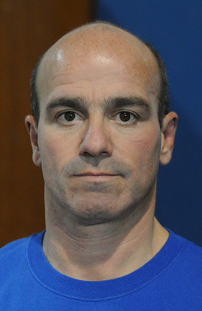 Danvers:<br /> Manny Costa is the wrestling coach at St. John's Prep.<br /> Photo by Ken Yuszkus/Salem News, Tuesday, January 10, 2012.