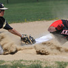 Peabody:<br /> Bishop Fenwick's Nick Bona tries to tag North Andover's Bobby Trickett as he slides safe into third during the North Andover at Bishop Fenwick baseball game. <br /> Photo by Ken Yuszkus/Salem News, Wednesday, April 18, 2012.