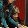 Salem:<br /> Mia Accomando, left, Salem High School freshman and member of the orchestra, serves a turkey dinner to Bettyjean Tilton during the Senior Citizen luncheon at Salem High. Over a hundred senior citizens were served turkey dinners and were entertained on Thursday.<br /> Photo by Ken Yuszkus/Salem News,  Thursday,  November 18, 2010.