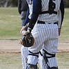 Wenham:<br /> Gordon's pitcher Eric Wolak and catcher Geoff Brown talk at the pitcher's mound in the first inning of the Eastern Nazarene at Gordon College baseball home opener.<br /> Photo by Ken Yuszkus/Salem News, Wedesday, March 23, 2011.