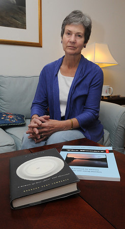 Hamilton:<br /> Barbara Kent Lawrence has written a book about her husband's anorexia, belemia and alcoholism, and the struggles she faced with his disorders. She is pictured with the two books she wrote ,Bitter Ice and  The Hungry i .<br /> Photo by Ken Yuszkus/Salem News, Thursday, March 10, 2011.