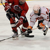 Salem:<br /> Beverly's Mitch Hamor grabs the puck from a Lynn player during the Beverly vs Lynn boys hockey game at Salem State University.<br /> Photo by Ken Yuszkus/Salem News, Thursday, February 24, 2011.