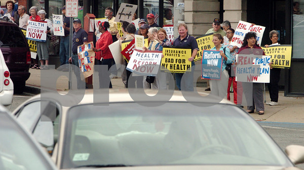 Peabody:<br /> People with signs mob the corner of Main Street and Foster Street during the rally that Bill Hudak, Republican Challenger held near Tierney's office.<br /> Photo by Ken Yuszkus/Salem News, Thursday, August 13, 2009.