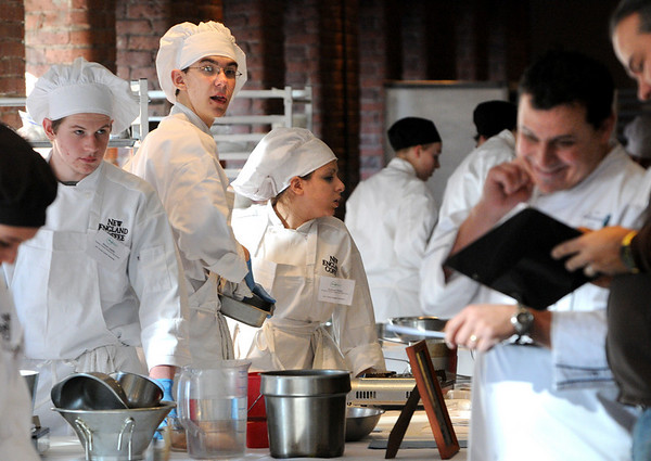 Boston:<br /> From left, Michael Almeida, Doug Toth, and Katherine Pittsley, Peabody culinary students, look toward the two judges as they compete during the state Prostart competition in Boston. <br /> Photo by Ken Yuszkus/Salem News, Friday, February 11, 2011.