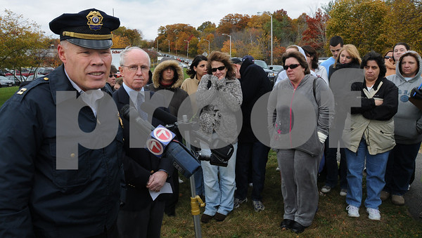 Beverly:<br /> From left, Beverly Police Captain Alan Petersen and James Hayes, superintendant of schools, address the media and parents in front of Beverly High School. The  lockdown of the school and the delayed dismissal time of 3 pm were discussed. There were 22 caliber long rifle bullets found in the school that prompted the decision to lockdown the school.<br /> Photo by Ken Yuszkus/Salem News, Wednesday, October 29, 2008.