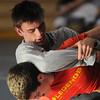 Danvers:<br /> TJ Crabtree, top, wrestles with Doug Harding during practice. TJ Crabtree is a senior wrestler at St. John's Prep who just won the Division 1 North individual tournament at 140 pounds.<br /> Photo by Ken Yuszkus/Salem News, Tuesday, February 15, 2011.