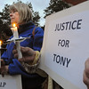 Ipswich:<br /> Barbara Jensen holds a lit candle and a sign, along with others, during the vigil held for Tony Woo at the center of town. Woo, owner of the Majestic Dragon restaurant on Route 1, was found dead on Tuesday, Sept. 27.  He was well-known and well-liked by folks in Ipswich.<br /> Photo by Ken Yuszkus/Salem News, Monday, October 3, 2011.