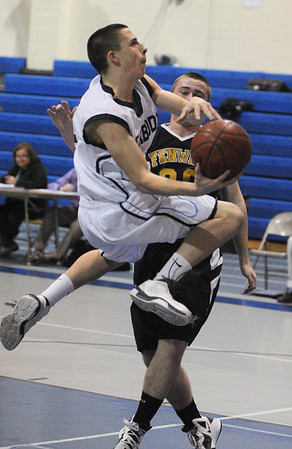 Peabody:<br /> Peabody's Steve Leavitt goes through the air for a shot at the net with Bishop Fenwick's Josh Gustin at his side during the Bishop Fenwick at Peabody boys basketball.<br /> Photo by Ken Yuszkus/Salem News, Monday, January 23, 2012.