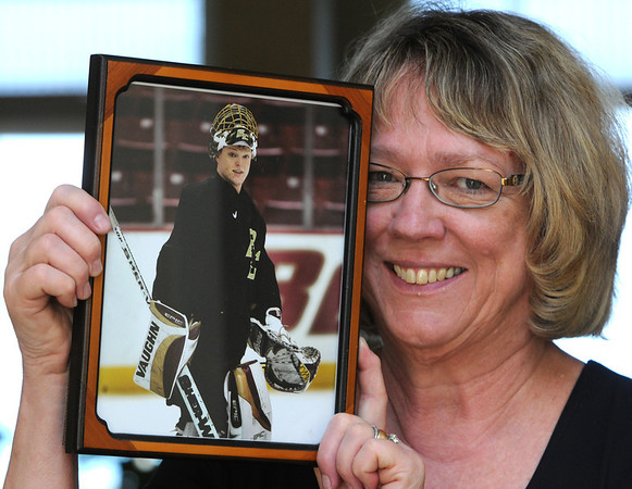 Swampscott:<br /> Susan Schneider holds a photo of her son, Corey Schneider, who is the backup goaltender for the Vancouver Canucks, who are playing the Boston Bruins in the Stanley Cup Finals. The photo is from Corey's Boston College hockey days.<br /> Photo by Ken Yuszkus/Salem News, Tuesday, May 31, 2011.