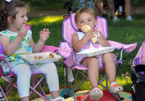 Danvers:<br /> Juliana Cunningham,2, right, bites into a hotdog as her friend Lucy Osborne,2, munches on potato chips while listening to the music of Britannica at the History, Harmony, Hot Dogs and Hits presented by the Danvers Historical Society at the Glen Magna Farms.<br /> Photo by Ken Yuszkus/Salem News, Monday, July 9,  2012.