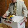 Salem:<br /> Salem Superintendent of Schools William Cameron is in his office with a box of some of his belongings that he will be taking home today after his last day as superintendent.<br /> Photo by Ken Yuszkus/Salem News, Friday, August 12, 2011.