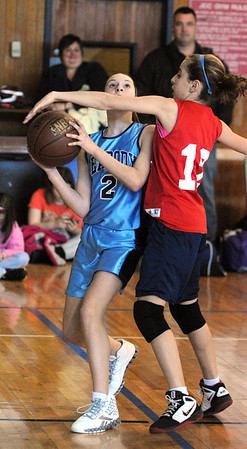 Marblehead:<br /> Mikayla Porcano, left, from the team, Blue Warriors, goes up for shot but gets resistance from Maggie Derande, from the team, The Swish, at the Jimmy Myers 3-on-3 Basketball Tournament held at the JCC of the North Shore.<br /> Photo by Ken Yuszkus/Salem News, Monday, January 16, 2012.