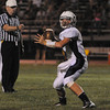 Salem:<br /> Peabody's Cody Wlasuk throws the ball to Jake Summit during the Peabody at Salem football season opener for both teams held at Bertram Field in Salem.<br /> Photo by Ken Yuszkus/The Salem News, Friday, September 7, 2012.