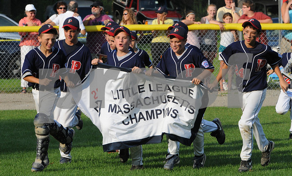 Beverly:<br /> Peabody West team ran along the edge of the field with their banner declaring them thewinners of the State Little League championship game of Peabody West vs Newton Central at Harry Ball Field.<br /> Photo by Ken Yuszkus/Salem News, Monday, August 3, 2009.
