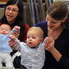 """Salem:<br /> From left, Lourdea Allison plays with her son Nicholas and Jen Weissman plays with her son Lucas while assisting with hand gestures and singing a song during the program """"Babies and Books"""" at the Salem Library on Wednesday morning. They live in Salem.<br /> Photo by Ken Yuszkus/Salem News, Tuesday, February 1, 2012."""