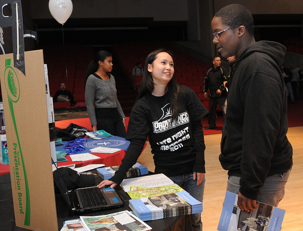 Salem:<br /> Suzan Le, left, a freshman at Providence College, discusses the college with William Murrell, a sophmore at Salem High School, during the fifth-annual alumni college forum at Salem High School.<br /> Photo by Ken Yuszkus/Salem News, Thursday, January 5, 2012.