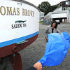 Salem:<br /> Thomas G. Brown, Jr., right, of Gloucester, donated his 34' Webber Cove power boat to Sail Salem. Salem Mayor Kim Driscoll is on the left helps unveil the new name on his boat at Dion Yatch Yard.<br /> Photo by Ken Yuszkus/Salem News, Tuesday, August 16, 2011.