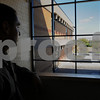Salem:<br /> David Angeramo, principal, looks out from the staircase, toward the large window in the lobby of the newly renovated Salem High School. <br /> Photo by Ken Yuszkus/Salem News, Monday September 15, 2008.