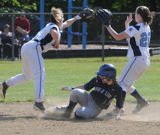 Peabody:<br /> Swampscott's Tori Thistle gets safely to second as Peabody's Katie Brunelle, left, and Kelly Donahue reach for the throw at the Swampscott at Peabody in Northeastern Conference softball game.<br /> Photo by Ken Yuszkus/Salem News, Monday, May 7, 2012.
