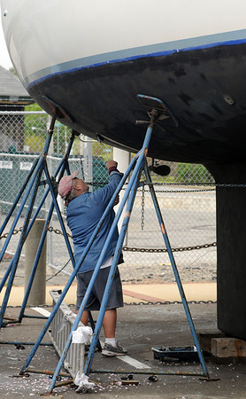 Beverly:<br /> Larry Marshall, of Florida, undercoats his 37 foot sailboat while readying the boat for the new season.<br /> Photo by Ken Yuszkus/Salem News, Wednesday, May 11, 2011.