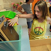 Danvers:<br /> Makayla Gongas, 4th grader at the Highlands Elementary School, is organizing the clipboards in her class which was one of the end of the year chores. Danvers last day of school is tomorrow<br /> Photo by Ken Yuszkus/Salem News, Monday, June 27, 2011.