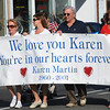 Danvers:<br /> From left, Laurie Miles, Karen Caron, Bill Caron, and Robin Rowell carry a banner remembering Karen Martin during the procession down Maple Street during the 9/11 observances in Danvers Sunday morning. Karen Martin was the head flight attendant on flight 11 who perished on 9/11.<br /> Photo by Ken Yuszkus/Salem News, Sunday, September 11, 2011.