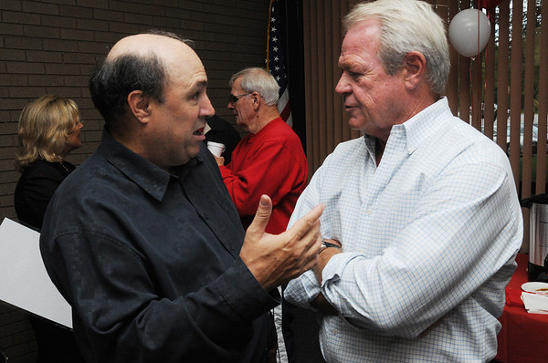 Beverly:<br /> Mike Grenier, left, speaks with Roger Rosinski, former head football coach of Beverly High School, during Mike's retirement reception at the Salem News on Thursday evening.<br /> Photo by Ken Yuszkus/Salem News, Thursday, September 8, 2011.