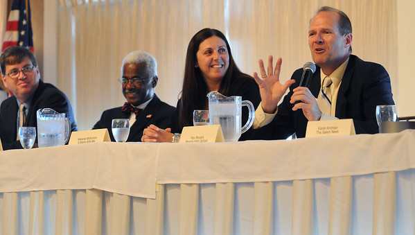 """Danvers:<br /> From left, Steve Dibble, of Dibble and Sons, Salem,  Charlie Desmond, state Board of Higher Education Chairman and Danvers resident, Melanie McKinnon, founder, """"It Starts With Me"""" fundraising organization, Salem, and Ray Novack, Beverly High band director, are all panel members speaking at the North Shore 100 Breakfast at the Danversport Yacht Club during North Shore Chamber's Economic and Public Policy Breakfast Forum.<br /> Photo by Ken Yuszkus/Salem News, Tuesday, May 5, 2010."""